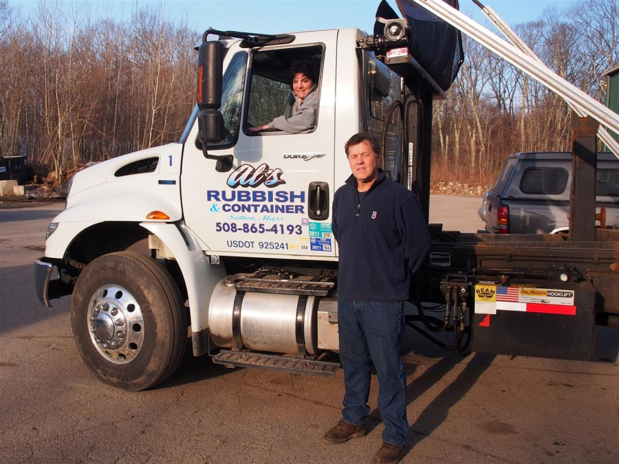 Al Gerard and one of his many rubbish removal trucks